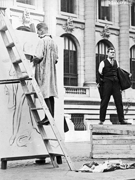Underwood & Underwood. [James Montgomery Flagg Reproducing his Poster], August 1, 1918. National Archives photograph 165-WW 61A-33.