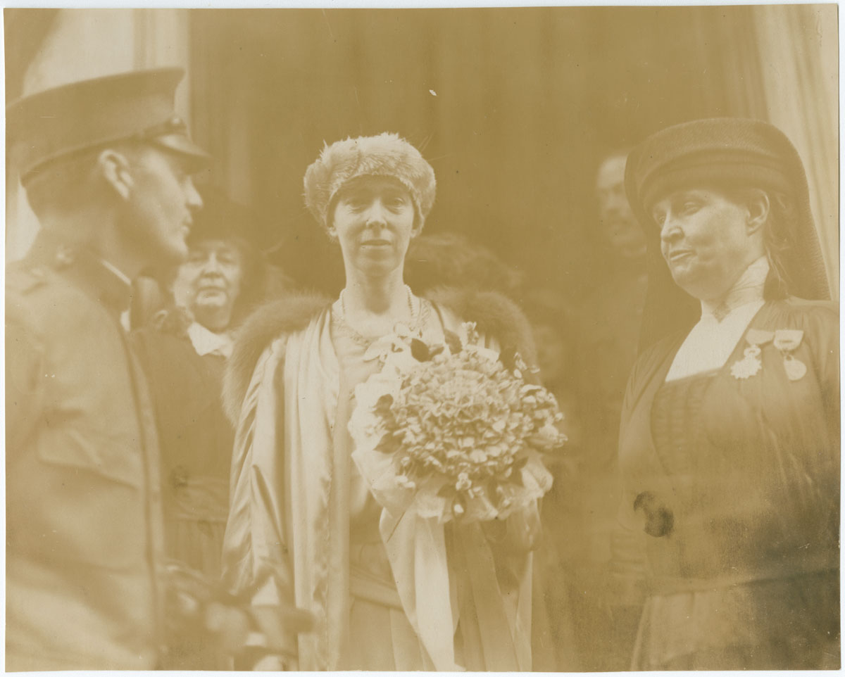 Queen Elizabeth of Belgium, at the Belgian Relief Committee Headquarters. Greeted by Chairman Mrs. Bayard Henry (Philadelphia, 1919). Gelatin silver photograph.